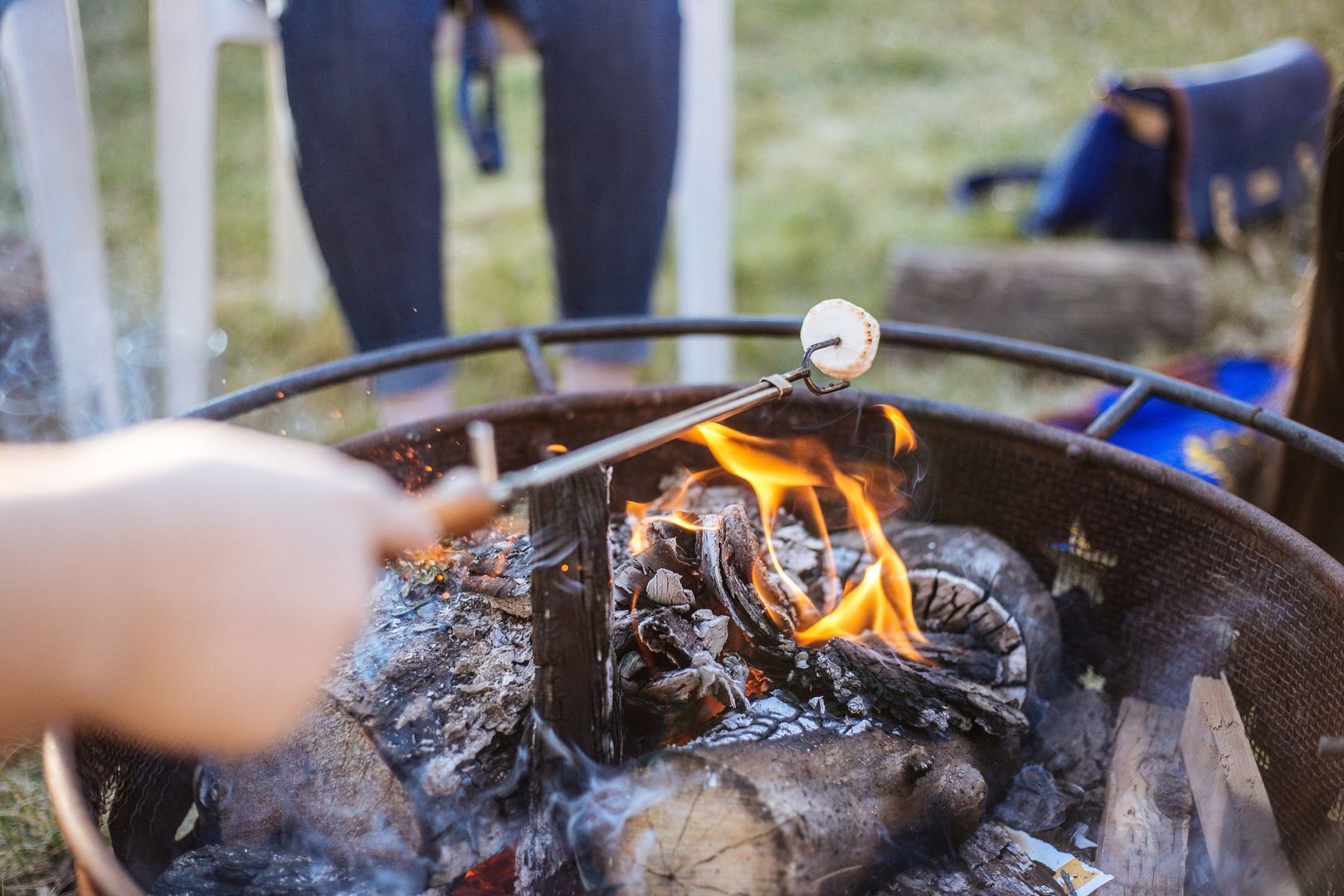Fire campfire hold holding